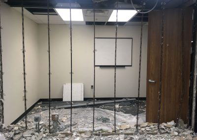 The wall between two offices is coming down to create a new conference room