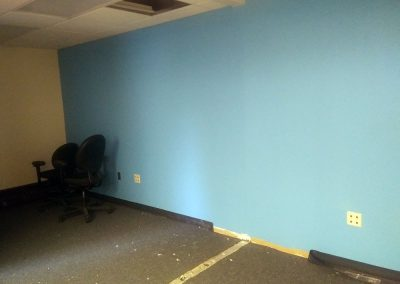 Freshly painted blue wall in our new conference room
